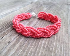 This listing is for a six strand beaded bracelet in stunning coral. This bracelet would go with any outfit, and pairs well with existing