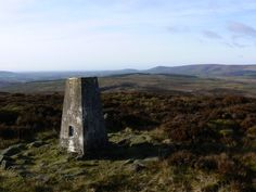 The trig point on Waddington Fell looking towards Parlick and Fair Snape Fell in the Forest of Bowland.