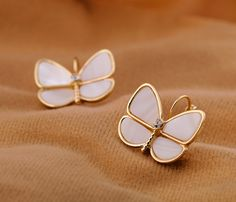 Feminine Shell Gold Plated Stud Earrings Read More:   http://wejewelry.net/feminine-shell-gold-plated-stud-earrings.html