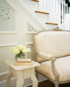 Laura Casey Interiors - entrances/foyers - blush pink settee, blush pink damask settee, french settee, foyer seating, cabriole leg side table, ivory side table, ivory roses, wainscoting paneled stairs, stairway molding trim, stairway molding ideas <3