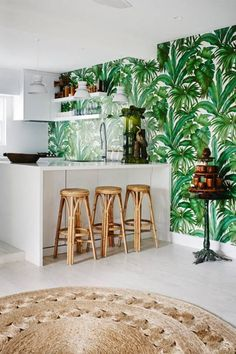 A vibrant palm wallpaper fits right in with the contemporary accents of the chic bar.