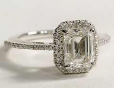 LOVE. This is what I'd want. Vintage feel, princess cut.
