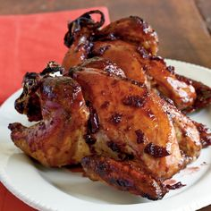 Roasted Cornish Hens with Cherry-Port Glaze | Ginger gives the sweet-tart cherry glaze a little bite atop roasted Cornish game hens.
