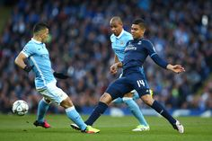 Casemiro of Real Madrid CF is closed down by Sergio Aguero of Manchester City during the UEFA Champions League Semi Final first leg match between Manchester City FC and Real Madrid at the Etihad Stadium on April 26, 2016 in Manchester, United Kingdom. (April 25, 2016 - Source: Paul Gilham/Getty Images Europe)