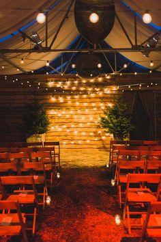 ceremony lighting, photo by Lauren Fair Photography http://ruffledblog.com/terrain-winter-wedding #wedding #ceremony #lighting