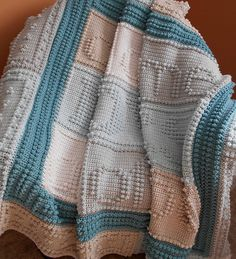 """This crocheted blanket makes a wonderful wedding or bridal gift. An original design, the blanket when finished says, """"all of me LOVES all of you."""""""