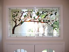 Would love to have something like this in the front door! Dogwood stained glass panel.