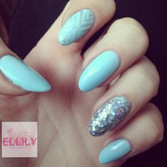 Pastel blue nails with silver accent nails
