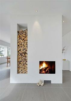 Since we have a gas fireplace I would leave the space for the wood open so the light would shine through