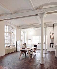 Architecture studio IFUB has transformed the second floor of an old chocolate factory in Berlin into an apartment featuring curved ceilings, exposed steelwork and big windows.