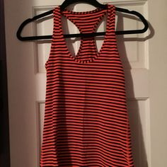 Lululemon Cool Racerback Tank Flare Stripe 6 Lululemon cool Racerback tank in size 6. Cute flare (orange) and inkwell (navy) stripe. Very good condition. lululemon athletica Tops Tank Tops