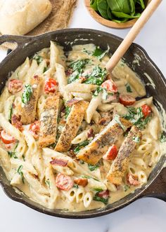 This loaded chicken bacon spinach pasta dish is tossed in a thick and creamy garlic Parmesan  sauce. It's a perfect blend of flavors that will make you think you're eating at a restaurant!