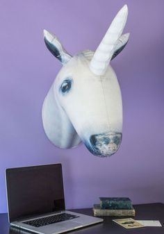 Because everyone needs a magical inflatable unicorn to hang on their mantle