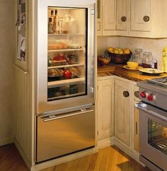 Glass Door Refrigerator  Over-and-under refrigerator / freezer with glass door from Sub-Zero