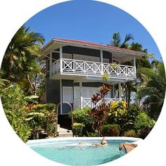 Description OverviewThe Vacation Club is a community of 12 private sea house villas nestled amongst the tropical palms and gardens of the northern hillside of Marigot Bay. Each Vacation Club villa has its own beautiful view overlooking the bay and marina. The units are perfectly
