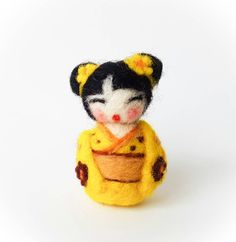 Needle Felted Yellow Kimono Japanese Kokeshi Wool Sculpture/Doll. DOLL/SCULPTURE ONLY - no accessories included This miniature needle felted red and pink floral kimono kokeshi doll is the perfect collectible or Valentine's day gift. The carefully hand-crafted wool sculpture is approximately 2in tall *Please note that I try to make all of my dolls as close as possible to what is displayed but some colours and sizes may slightly vary since this item is free-hand, hand-made. **This item is…