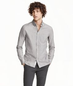 Long-sleeved shirt in washed cotton with a button-down collar, chest pocket and yoke seam with a loop at the back. Regular fit.