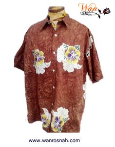 Batik Shirt hand drawn in cotton 100%. For casual wear. Batik motif in hibiscus  and can be in different colours. Available from www.wanrosnah.com