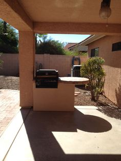 Imagine a barbeque in this nice backyard with brick patio and built in gas barbeque pitt.