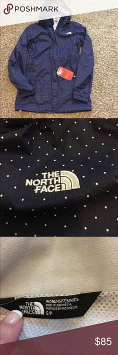 The North face Resolve Parka Navy blue and white polka dot- this jacket is so adorable! The hood can be rolled up and tucked in! Zipper and Velcro front closure! Any questions please don't hesitate to ask! Size Small! New with tags! The North Face Jackets & Coats