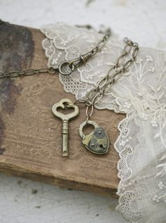handmade necklace with vintage brass lock and key on an aged brass chain. Chain is 30 long and comfortably fits overhead without having to unclasp it.
