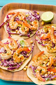 Smoky, grilled shrimp and spicy slaw are the keys to next-level tacos.Get the recipe from Delish. - Courtesy of Ethan Calabrese Easy Grilled Shrimp Recipes, Grilled Shrimp Tacos, Pork Rib Recipes, Grilled Seafood, Grilling Recipes, Seafood Recipes, Mexican Food Recipes, Cooking Recipes, Grilling Ideas