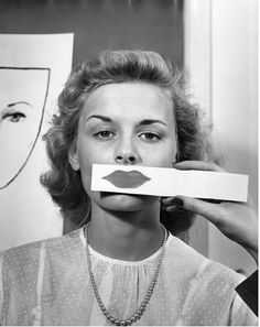 mpdrolet:  Teenage Girl Tests Lipstick Shapes and Color, 1945      Nina Leen