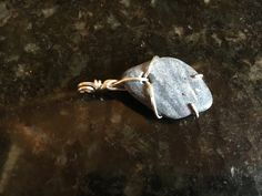 Petrified Shell Pendant by KainaluCreationsCo on Etsy