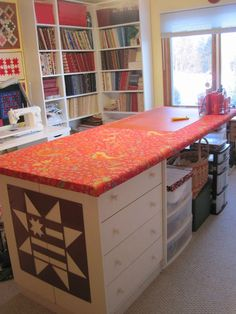 Cutting table covered with batting and fabric.  Perfect for ironing, use a cutting mat for fabric cutting.