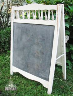 repurpose an old baby crib into an easel a drying rack or trellis