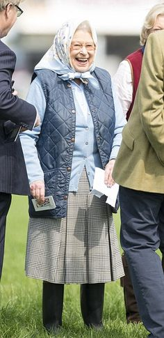 The Queen smiles in the sunshine during a visit to Windsor Horse Show today - one of her f...