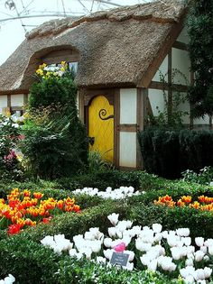This real house would make a great doll house.  <3 the thatched roof, <3 the embedded beams, <3 <3 <3 the curlicue on the door.