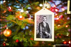 Ancestor wedding photo hanging on a Christmas Tree at Oxon Hoath wedding venue