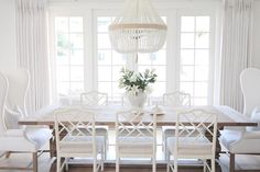 @JSHOMEDESIGN- Beautiful white milk beaded chandelier by Ro Sham Beaux, Restoration hardware trestle table.
