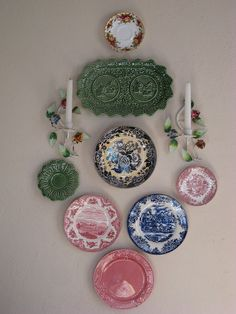 a wall display of mismatched plates complements my new vintage tole candleholders - Decorative Christmas Display Plates