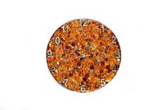 Wall clock (diameter 300 mm, thickness 15 mm) in an amber mosaic with gold numerals. Coating - lacquer , polishing.