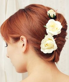 french twist with roses hairstyles for brides