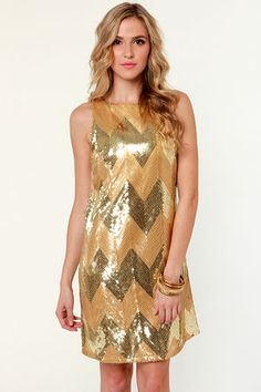 Check it out from Lulus.com! Eureka! You've just struck 24 karat cuteness with the BB Dakota Malia Gold Sequin Dress! This sleeveless shift dress combines shiny and matte gold sequins into a flashy zigzag pattern from boat neckline to A-line hem. Darted bust. Invisible side zipper. Fully lined. Model is wearing a size X-small. XS measures 33