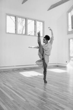 does warm-up exercises in her dance studio as her dog, Adelaide, observes in 1982, by Moneta Sleet Jr.