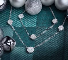 The Naledi Collections white gold flower halo necklace and bracelet set is perfect for the holidays.