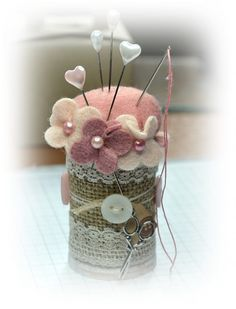 Wooden spool pin cushion. When you look at this, you could take an old/empty coffee can, embellish it as you like and make a great little sewing kit.