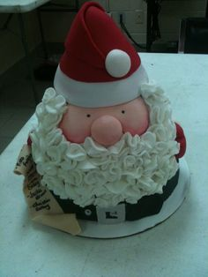"This is Royal Bakery's Jolly Santa cake. I made it for a work pot luck, so excuse the ugly background ;) The names on the ""naughty list"" are the upper management team from work. I used strawberry cake with strawberry buttercream for the cake. Christmas Cake Designs, Christmas Cake Decorations, Christmas Sweets, Holiday Cakes, Christmas Baking, Christmas Cakes, Xmas Cakes, Father Christmas, Santa Cake"