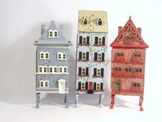Two handcrafted miniature row house by Sherry Scott, 1996 & 1997, one row house by Charlotte Scott made in 2000, tallest 7 1/2 in.