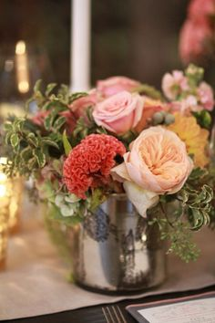 PEach and coral flowers in mercury glass. Photography by Kimberly Coccagnia