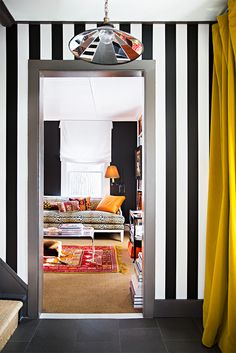 See inside a modern and glamorous Connecticut home decorated by interior designer, Patrick Mele. He transforms a Connecticut seaport home into a thoroughly modern residence for his design-savvy parents. For more home tours go to Domino. Striped Hallway, Striped Walls, White Hallway, Design Hotel, House Design, Living Room Designs, Living Room Decor, Maximalist Interior, Flur Design