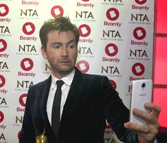 (GIF)David Tennant backstage at the NTA Awards taking a Selfie  Beamly was giving the stars phones with which to take Selfies in one of the backstage press areas