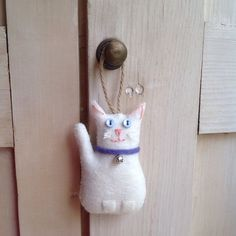 A personal favourite from my Etsy shop https://www.etsy.com/uk/listing/271407188/hanging-felt-little-white-cat