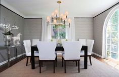 million dollar black and white room images   Dining room with graphic wallpaper, black crown molding, a black table ...