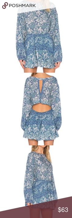 """FREE PEOPLE Patterned Open-Back Dress :Washed Blu Breezy silhouette with a chic open back Roundneck Long sleeves Elasticized waist Side slash pockets Open back Fully lined About 15"""" from natural waist to hem Rayon/cotton Machine wash. Any questions ask! Free People Dresses Mini"""