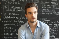 Childrens book illustrator and artist, Oliver Jeffers. I imagine his signings burst at the seams with moms wanting a moment with him...